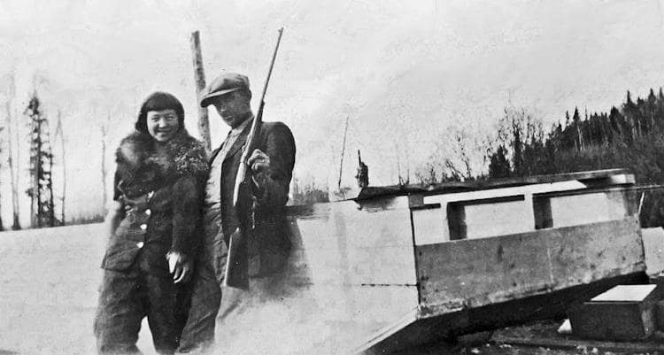 Halvor and Mary Ausland at Deep River with their scow.