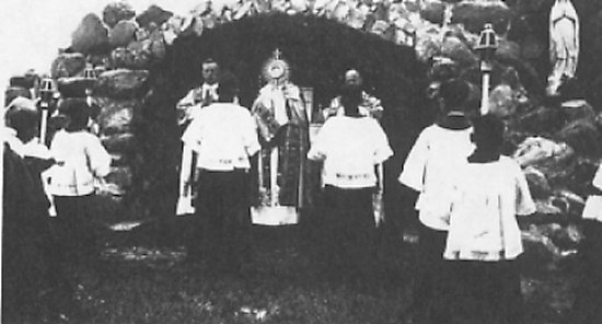 A stop at the grotto during the procession.