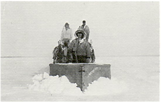 Ploughing a route, 1937. Alex Rushman in front steering the plough.