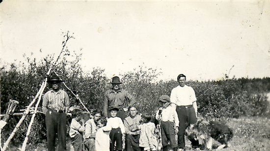 Natomagen Family and Ed Theriau (center)