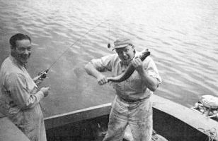 Fishing with Bill McKinnie (right) at La Ronge, 1952.