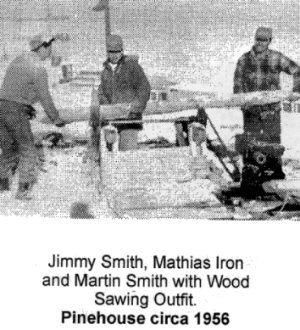 Jimmy Smith, Mathias Iron and Martin Smith with wood sawing outfit. Pinehouse circa  1956.