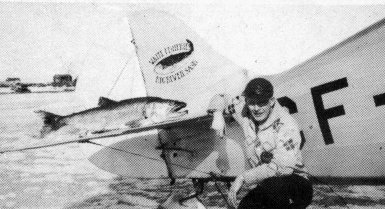 george greening, with a large lake trout on the stabilzer <br>  of the Waco BBQ which he flew for Waite's Fisheries