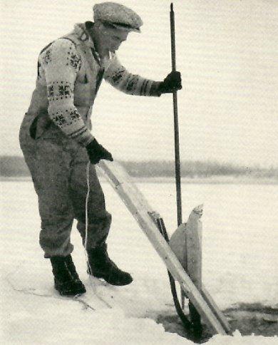 The jigger is put into the water, to creep beneath the ice and be taken out through another hole.