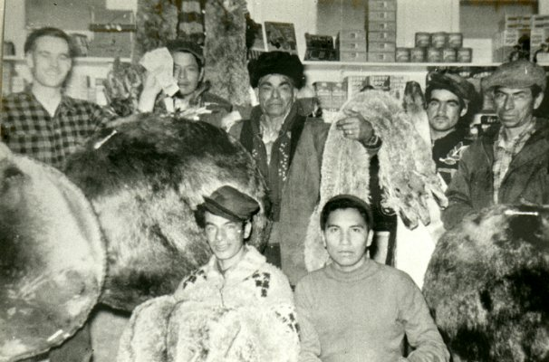 Tom Natomagan of Pinehouse selling furs to Ron Clancy