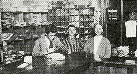 Frank Michie, Alex Afanasieff, and Mr. Forbes inside the Post Office