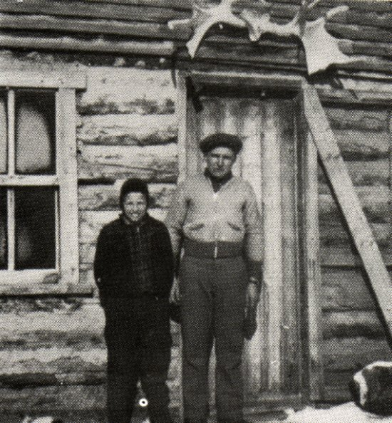 Teacher Kirt Newman and student Dennis Anderson in front of Louis Pelchat's store.