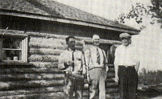 In front of Skalopski's house, Harry Pelchat with Albert and Mr. Thibeault who were the first store and Post Office owners.