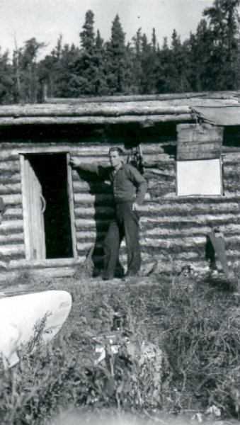 Fred Darbyshire outside of his trapping cabin