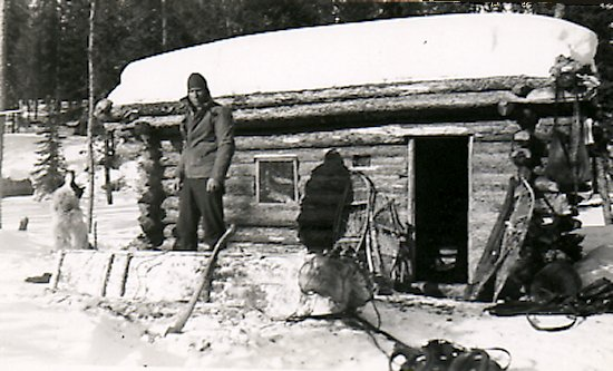 Fred Darbyshire in front of his trapping cabin