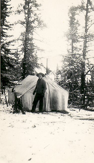 Fred in front of his tent camp