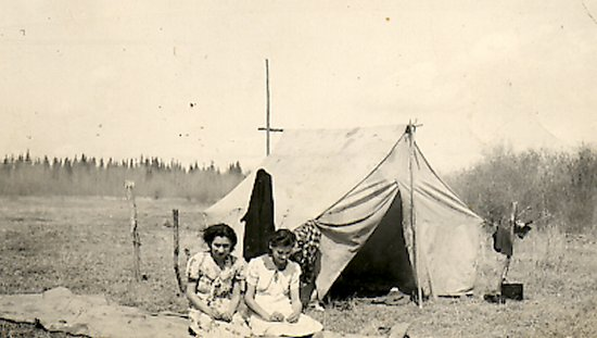 Two ladies in front of a tent