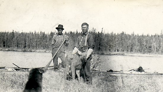 Trapper and Native with a moose calf