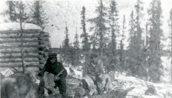 Trappers preparing fur pelts