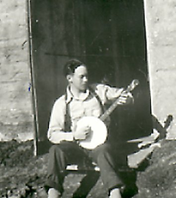 Ed Dahlby playing the banjo on the Bodmin homestead in 1937.