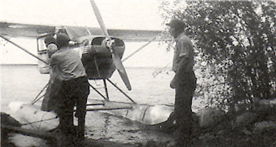 Saskatchewan ambulance plane taking out a patient from Dore Lake; before the time of good roads.