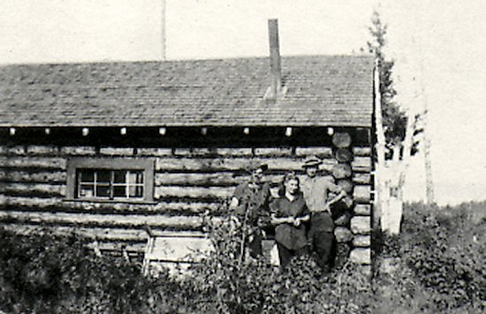 Dore Lake Cabin, which stood on the beach where the camp kitchen now stands at Tower Beach. L-R Dawson Bekett, Joyce Johnson, and the field officer Clarence Snell. Summer 1946.