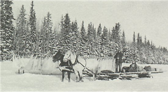 1941, Emil and Alexandra Zinovich heading out to Big River at the end of the winter season. The nets were left out to dry and collected just prior to break-up.