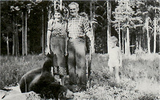 August 1961. Mary McBride (left), Del Joncas (center) and Vrian Craig (right), with black bear.