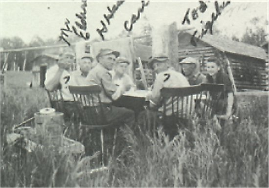 Mary Husak sitting next to Ted Figeland. Harry Husak sitting to the left of Mr. Harold Eldridge. Carl Johnson sitting across from Harry.