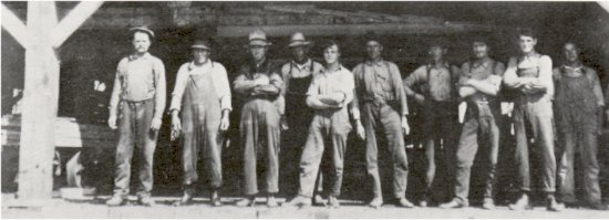 Big River Consolidated Fisheries sawmill workers (1919 - 1924) <BR> standing in front of the mill, on Dore Lake Island.