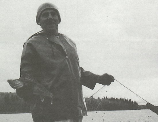 Stewart Thompson outside brother Jack's Camp with a Walleye Pike Pickerel.