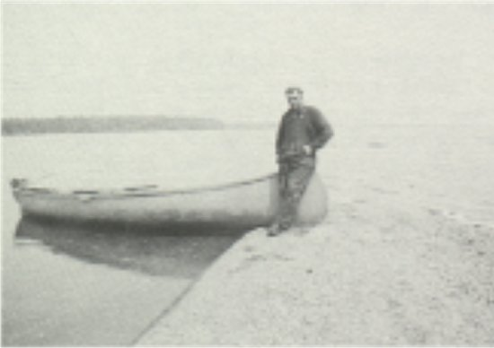 Emanuel Wynn, halfway between Potato Island and Moose Island. Standing on a low-water reef. Middle 1930's.