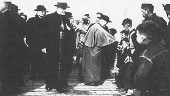 The children stand in line to greet the Cardinal.